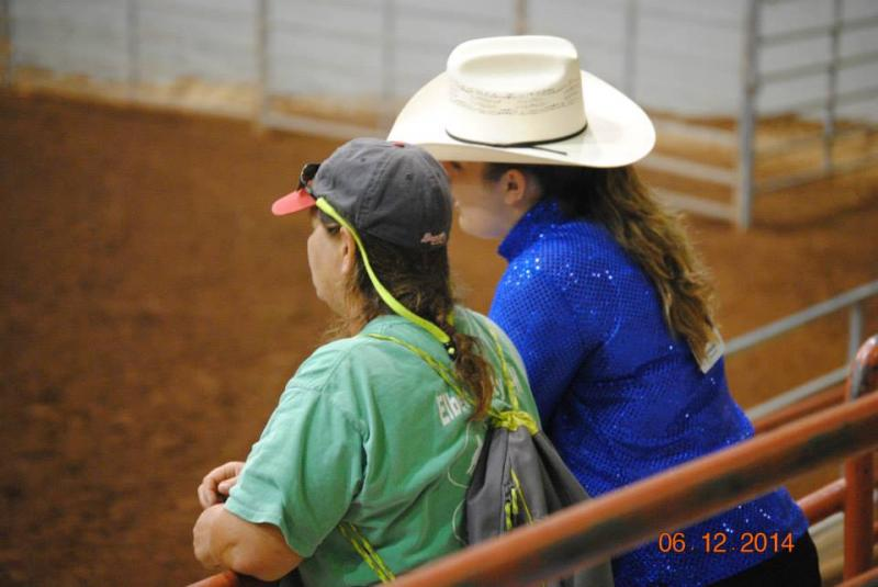 Dixie and Caroline analyzing the horsemanship pattern at the State 4-H Show.